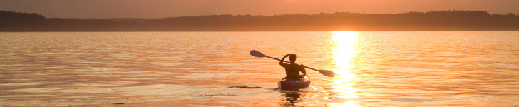 Lone kayaker at sunset