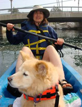Mary kyaking with her dog